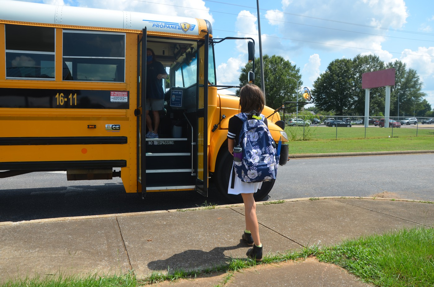 Student boarding a school bus