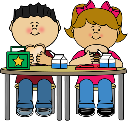 two students sitting at table eating lunch