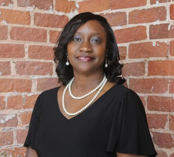 Michele Geathers McPhatter, Compliance Director