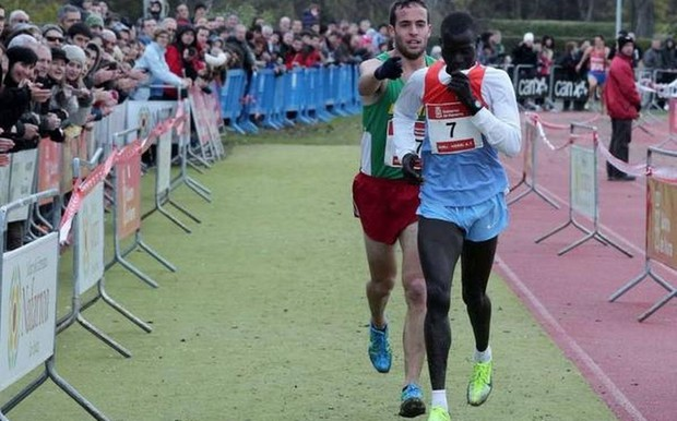 Ivan Fernandez and Abel Mutai at the finish line of a long-distance race
