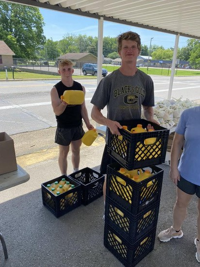 CHS students assisting with orange juice distribution.