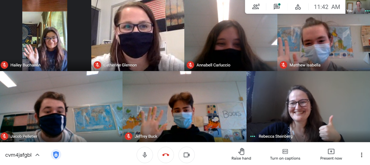 Google Meet screenshot of students and guest speaker looking at camera and waving