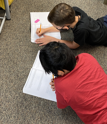 5th Graders Solving Math Word Problems Together