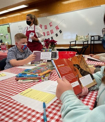 Making learning fun! 4th graders at the book tasting cafe.