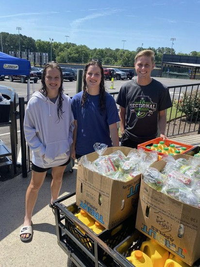 CHS swim team students assist with meal distribution.
