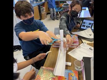 Students designing a suspension bridge