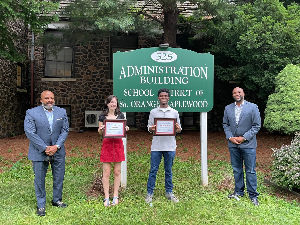 Lily Forman and Jakhi McCray receiving their certificate of appreciation from Superintendent Taylor and Board President, Joshua Thair.