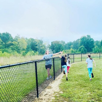 """Coach Moseley goes the """"extra mile"""" in Running Club."""