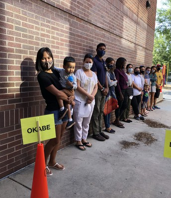 Parents stand in line for Mrs. Okabe