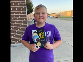 This student is reading last week's book recommendation!
