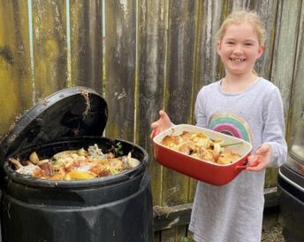 Sophia putting scraps in the compost bin!