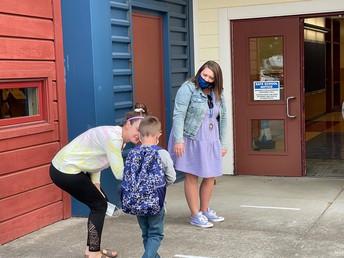 Principal Halley greets students at CES