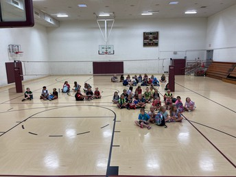 Students prepare for the morning by meeting with friends in the gym
