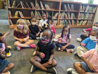 Students Practice Using Gentle Hands with Egg Shakers Before Checking Out Library Books