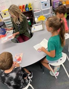 Mrs. Huff pulls a small group of readers!
