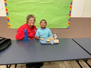 Grandma Marilyn welcomes students for breakfast