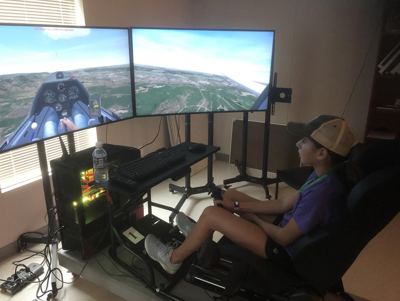 student in a flight simulator