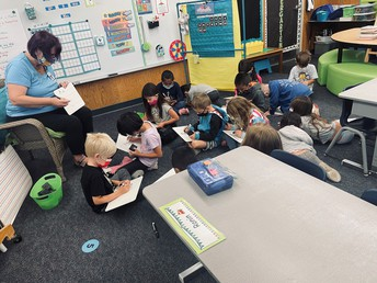 Kinder students learning to write