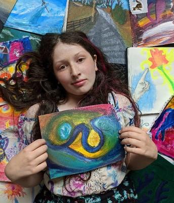 Sarah with her artwork