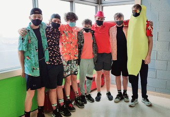 Grade 9-8 boys stand out in their beach shirts for Laser Tag!