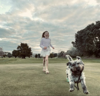 Zara makes sure her dog Fred gets much needed exercise!