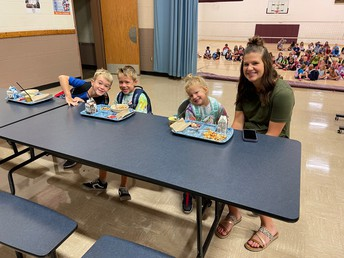 Mrs. Urban joins students in the cafeteria
