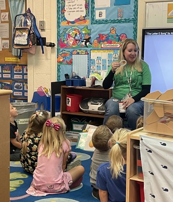 Ms. Lauren teaches upper case and lower case letters