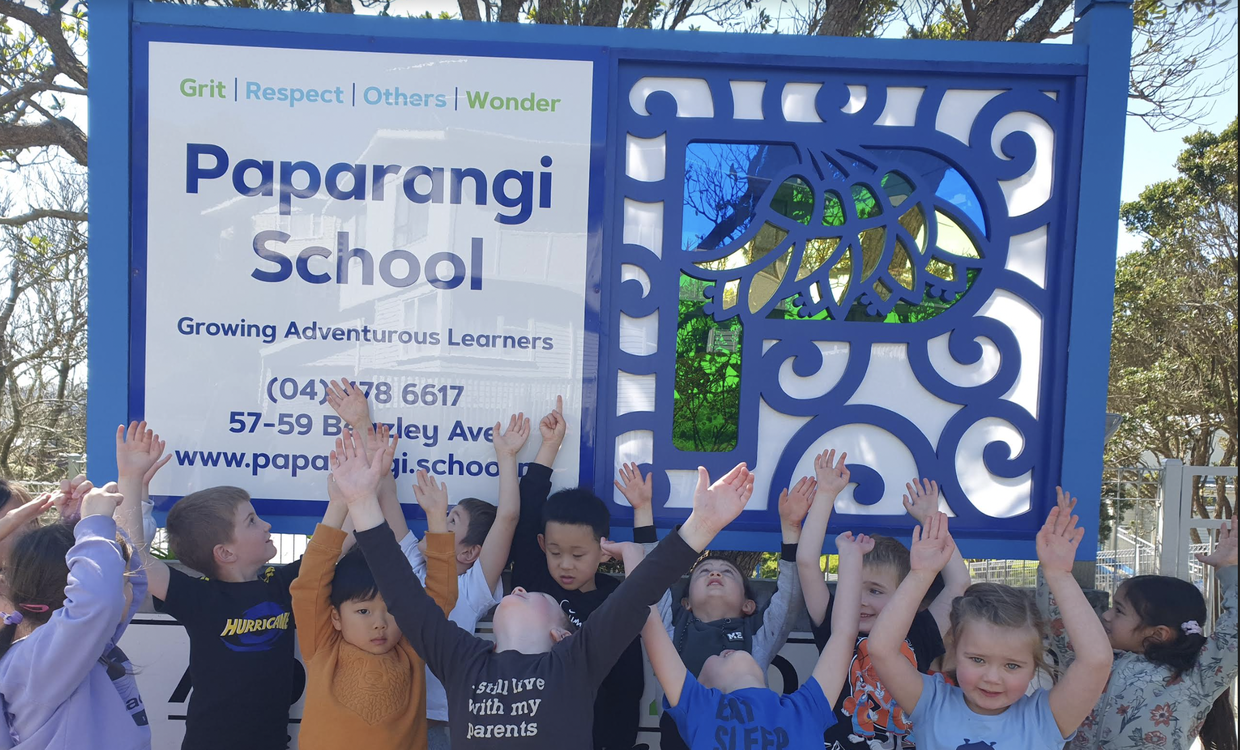 Here are some of the tamariki from Uenuku checking the new sign out! They like how the sun shines through the P!