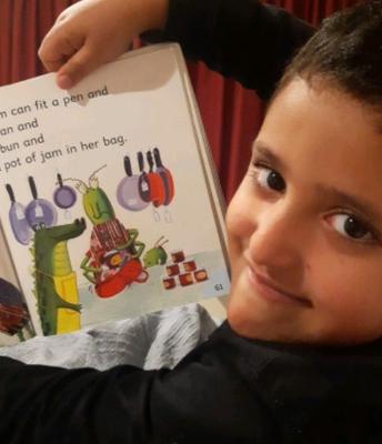 Issa practicing reading