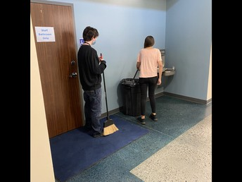 Office Aides helping clean