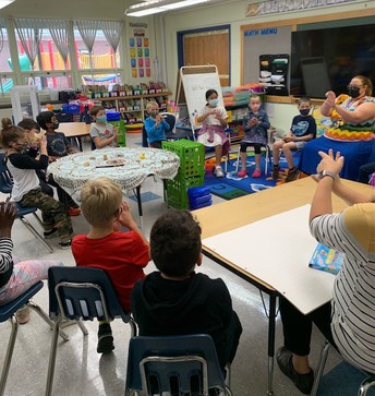 Taking a mindful moment - practicing 5 finger breathing in Mrs. Custer's class with Ms. Finlayson.