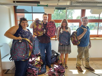 TCC Donated backpacks to all 3 of our SB elementary schools!