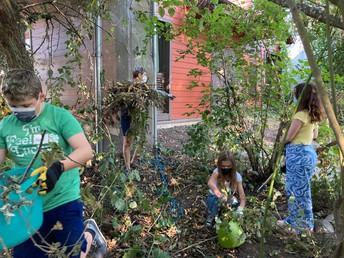 Artists working on getting our water garden spruced up!