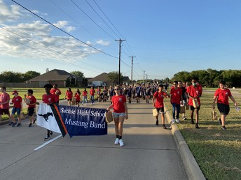 Band Officers Carry Banner