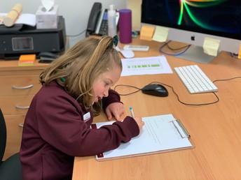 Principal Georgia signs important paper work
