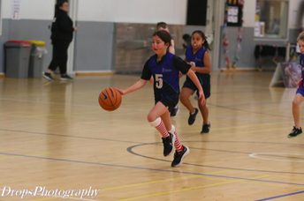 Jessica T dribbling the ball towards the hoop