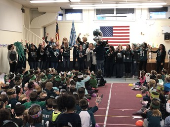 """Staff sings """"Fly Eagles Fly"""""""