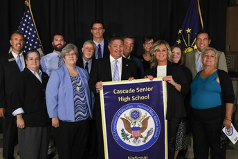 Supt McCormick presents banner to CHS