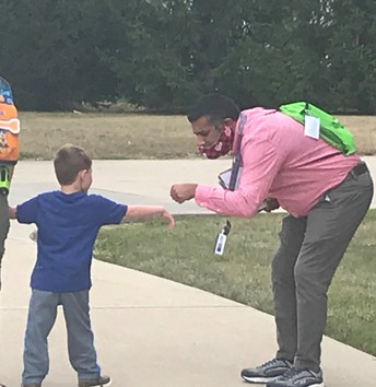 Mr. Singh says goodbye to a friend after school