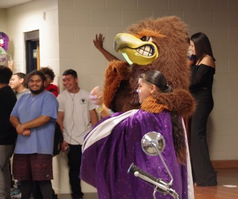 Dean Campus Town Hall with Hawk mascot and student.