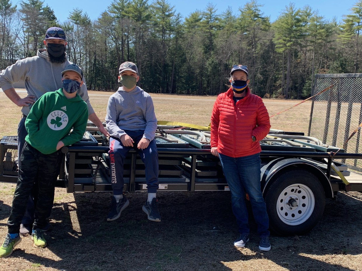 SC member Toby Bassett with his sons and Superintendent Stanton; standing by trailer with picnic tables