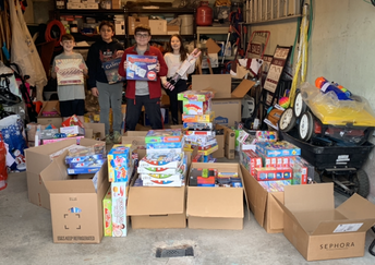 Sorting through the 300+ toy donations