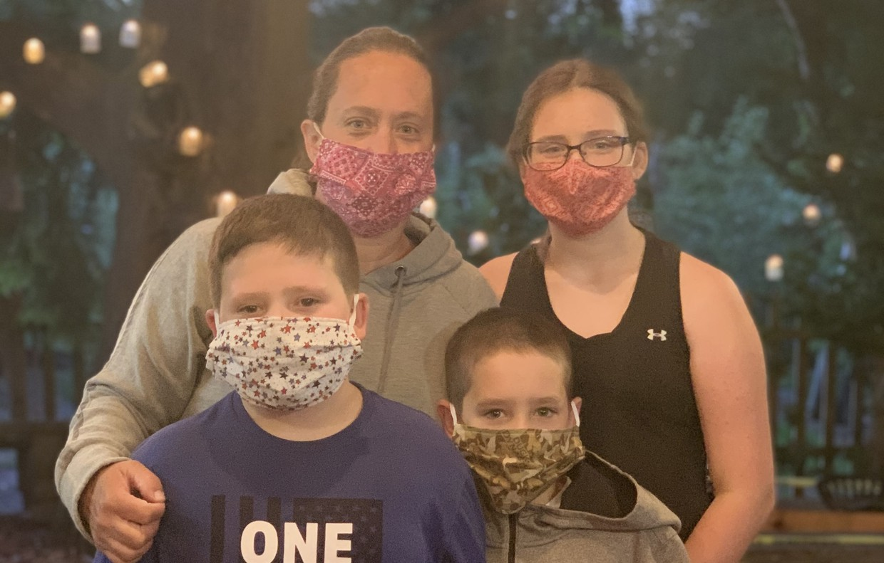 HPS Pupil Services head and her family wearing their mask.