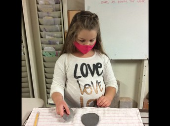 Maci prepping her clay for ceramics
