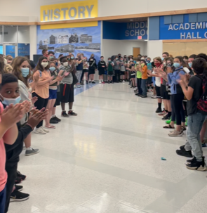 """students lining hallway for 8th grade """"clap out"""" ceremony"""