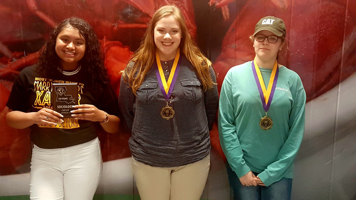"""Opelousas High School students win at the Louisiana State Social Studies Fair. After qualifying in several vigorous rounds of competition at the school level, parish level and regional level, Olivia Adams and Abigail LaHaye won Second Place in Political Science for their project """"Dreamers for DACA""""; and in Sociology-Ahraf Swati and Taylor Guillory placed First for """"Salem Witch Hunts in Modern Society."""" Congratulations to these talented students!"""
