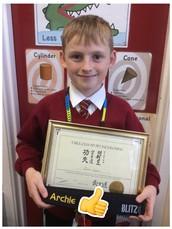 Archie shows off  his black belt too - fantastic achievement!