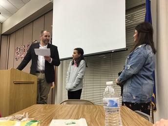 Lindsey listens as Mr. Lyon reads her leadership nomination!