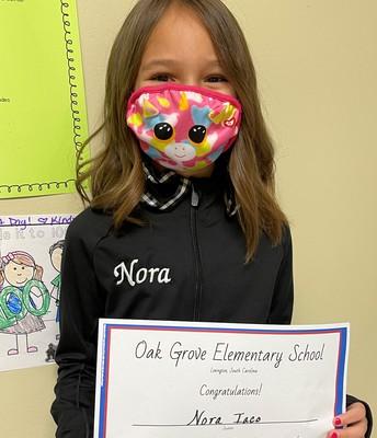 Nora was caught working hard!