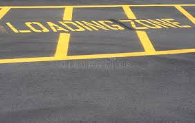 Use caution in Loading Zone Avoid Cell Phone Use